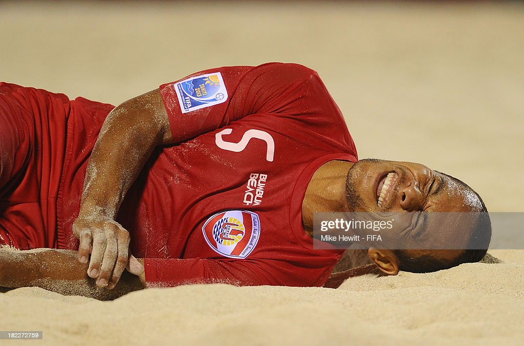 Raimoana Bennett of Tahiti is injured during the FIFA Beach Soccer World Cup Tahiti 2013 3rd Place Playoff match between Brazil and Tahiti at the Tahua To'ata Stadium on September 28, 2013 in Papeete, French Polynesia.