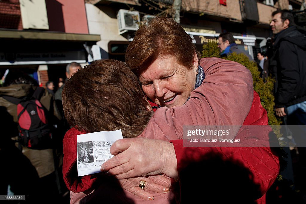 Raimunda Perez (R) and Angelines (L) celebrate as they win a top prize ticket number in Spain's Christmas lottery, 'El Gordo' (Fat One) on December 22, 2013 in Leganes, near Madrid, Spain. This year's winning number is 62246, with a total of 4 million euros for the top prize to be shared between ten ticket holders. The total prize fund is worth 2.5bn.