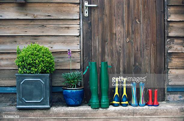Rain boots and plants on porch