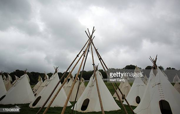 Rain clouds gather over some of the several hundred tipi tents that will be eventually available for hire at the Glastonbury Festival of Contemporary...
