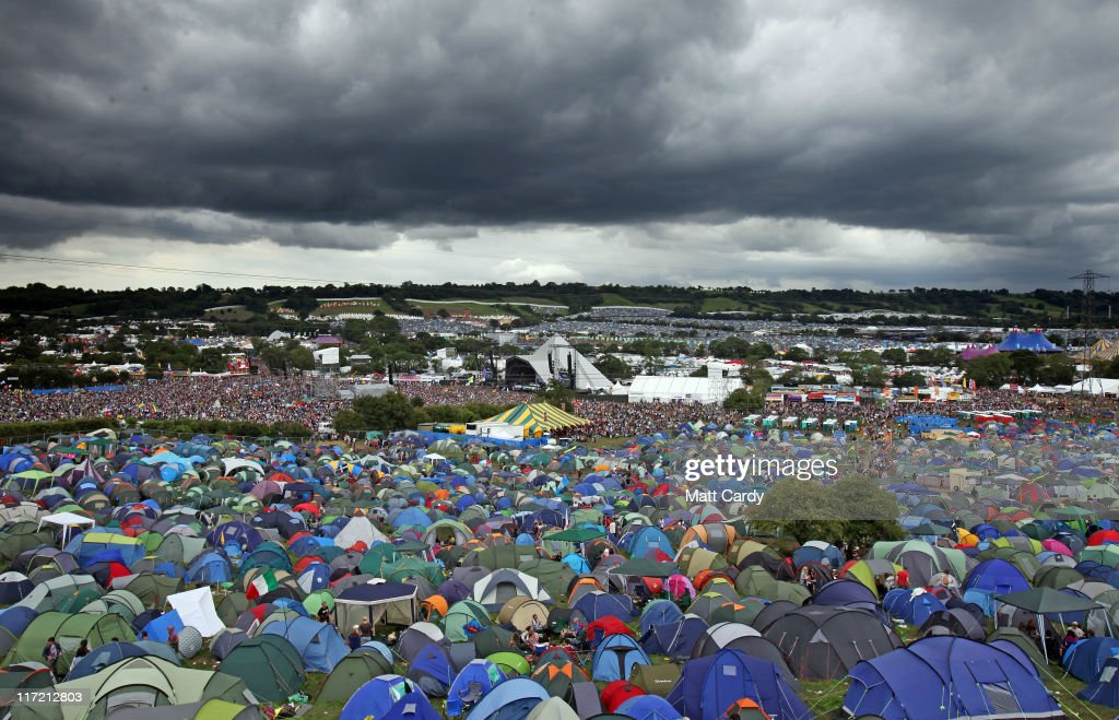 Rain clouds gather over the Pyramid Stage at the Glastonbury Festival site at Worthy Farm, Pilton on June 24, 2011 in Glastonbury, England. Music fans had to brave more rain today at the five-day festival which opened Wednesday. This year the festival will feature headline acts U2, Coldplay and Beyonce. The festival, which started in 1970 when several hundred hippies paid 1 GBP to watch Marc Bolan, has grown into Europe's largest music festival attracting more than 175,000 people over five days.