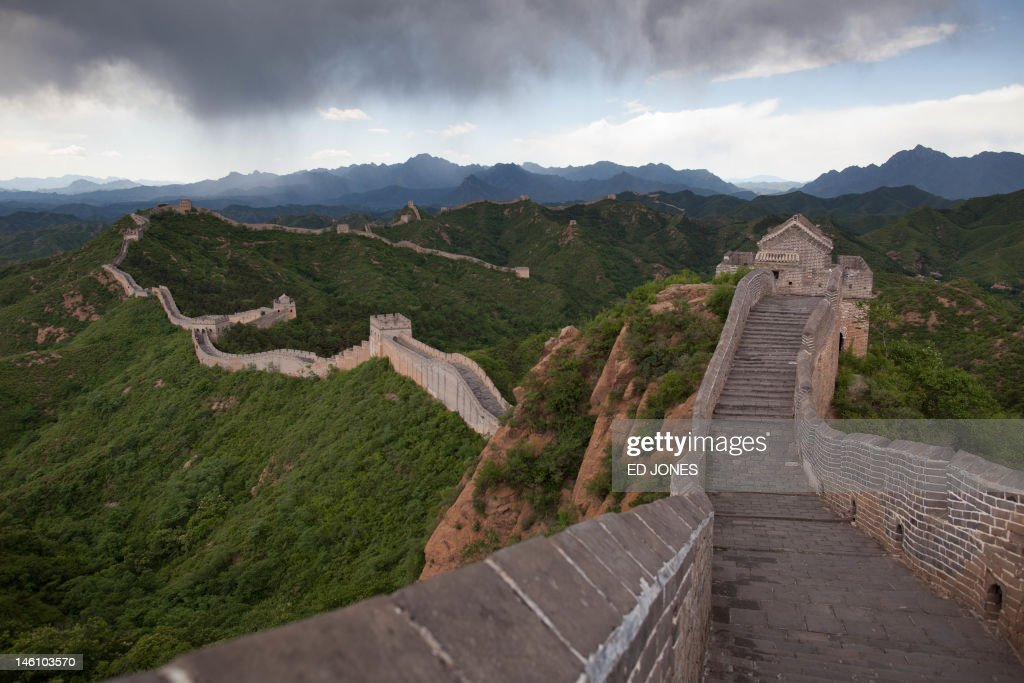 Rain clouds pass over a section of the Great Wall at Jinshanling Hebei Province on June 10 2012 The wall which is a series of fortifications made of...