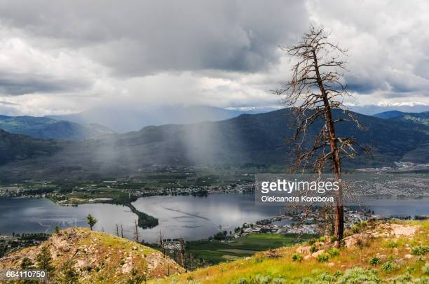 Rain clouds rolling over the town and lake Osoyoos, Southern British Columbia, Canada.