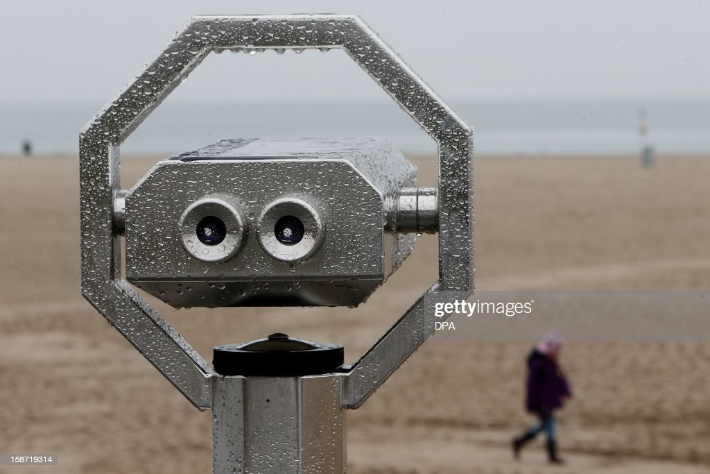 A rain covered look-out telescope stands on the Baltic Sea beach of Travemuende, northern Germany on December 25, 2012.