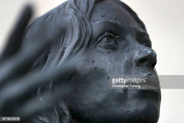 Rain covers the face of a statue during the annual Armistice Day Service at The National Memorial Arboretum on November 11 2017 in Alrewas England...