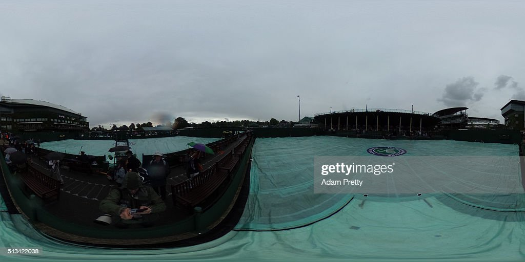 A rain delay on day two of the Wimbledon Lawn Tennis Championships at the All England Lawn Tennis and Croquet Club on June 28, 2016 in London, England.