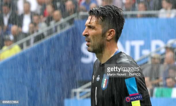 Rain drips off the nose of Italy goalkeeper Gianluigi Buffon