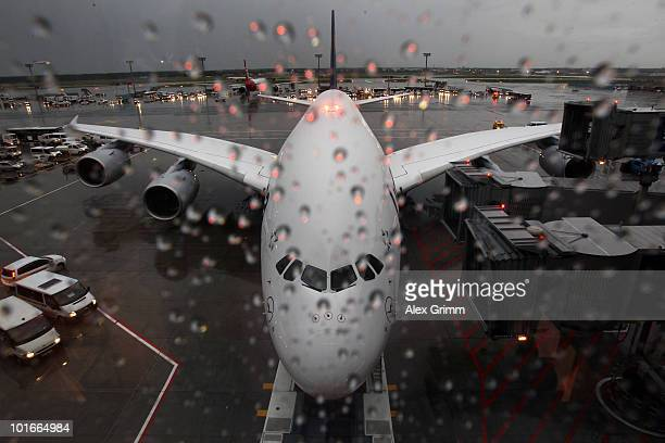 Rain drops are pictured on a window as the German national football team on board of the new Lufthansa Airbus A380 airplane is ready for their...