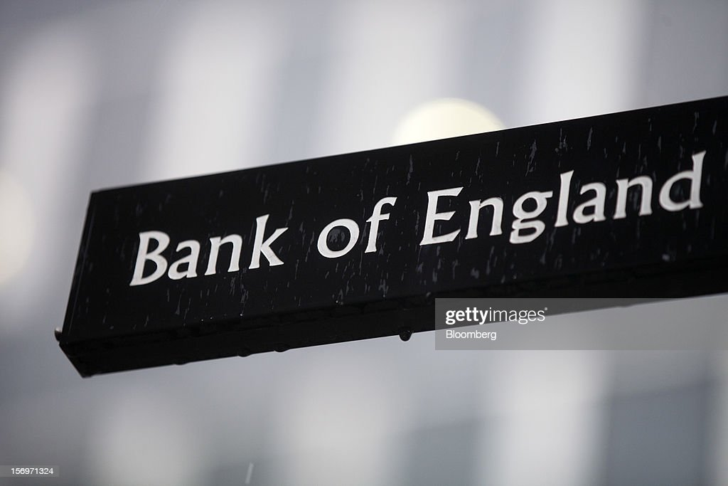 Rain drops are seen on a sign near the Bank of England (BOE), in London, U.K., on Friday, Nov. 23, 2012. Bank of Canada Governor Mark Carney was unexpectedly appointed as the next head of the Bank of England, succeeding Mervyn King. Photographer: Simon Dawson/Bloomberg via Getty Images
