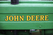 Rain drops drip from a vintage John Deere tractor on display at the Iowa State Fair on August 7 2014 in Des Moines Iowa The fair opened today and...