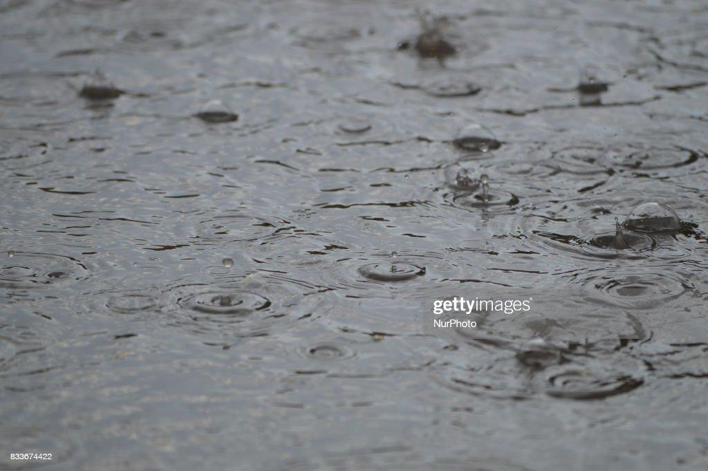 Rain drops fall down on water surface as summer rain hits Ankara, Turkey on August 17, 2017.