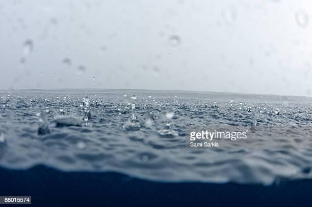 Rain drops falling into ocean (split shot)
