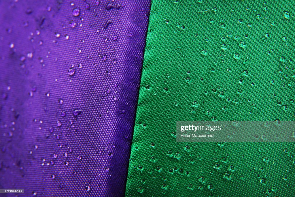Rain drops glisten on a Wimbledon branded umbrella at the Wimbledon Lawn Tennis Championships on July 2, 2013 in London, England.