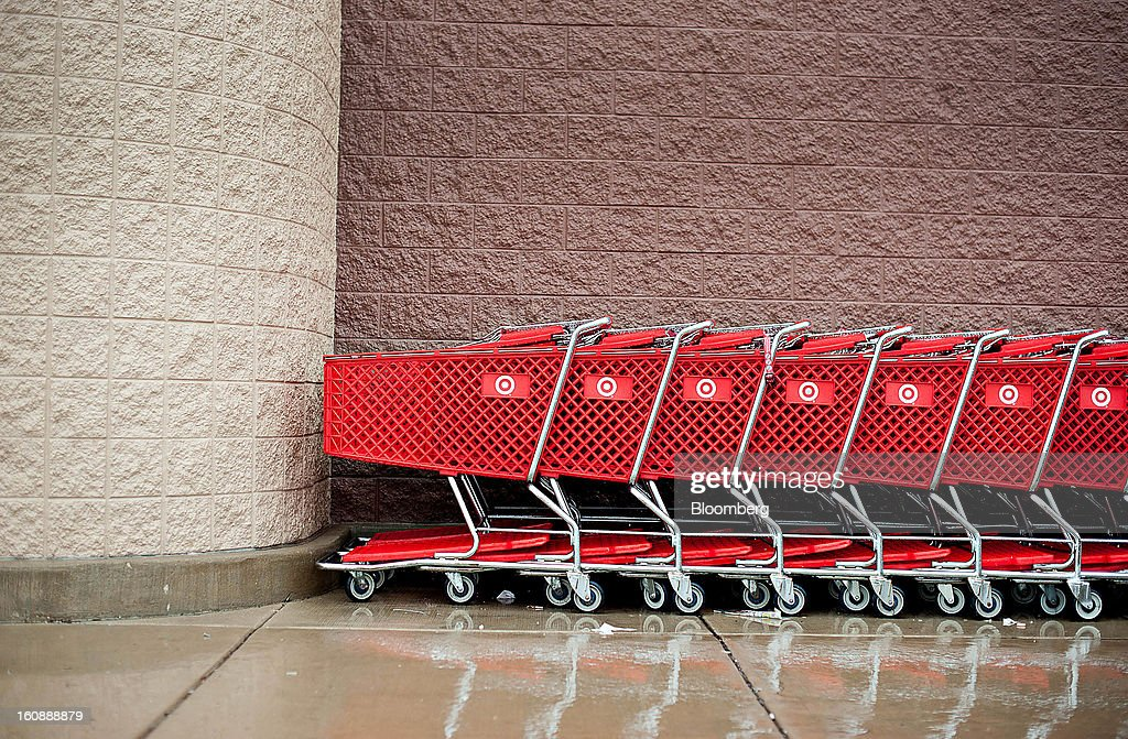 Rain drops sit on shopping carts sit outside a Target Corp. store in Peru, Illinois, U.S., on Thursday, Feb. 7, 2013. Target Corp. led U.S. retailers to the biggest monthly same-store sales gain in more than a year as shoppers snapped up discounted merchandise chains were clearing out after the holidays. Photographer: Daniel Acker/Bloomberg via Getty Images
