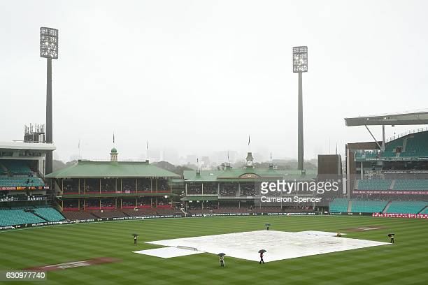 Rain falls before the start of play on Jane McGrath Day during day three of the Third Test match between Australia and Pakistan at Sydney Cricket...