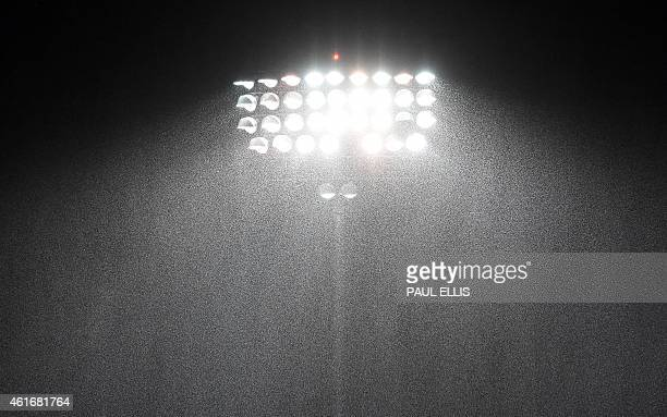 Rain falls in front of the floodlights during the European Rugby Champions Cup rugby union match between Sale Sharks and ASM Clermont Auvergne at AJ...