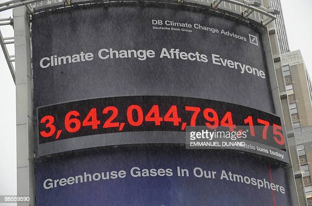 Rain falls in front of the world's frst realtime carbon counter which displays greenhouse gases amount in the atmosphere after it was unveiled by...