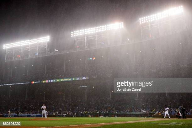 Rain falls in the eighth inning during game four of the National League Division Series between the Washington Nationals and the Chicago Cubs at...