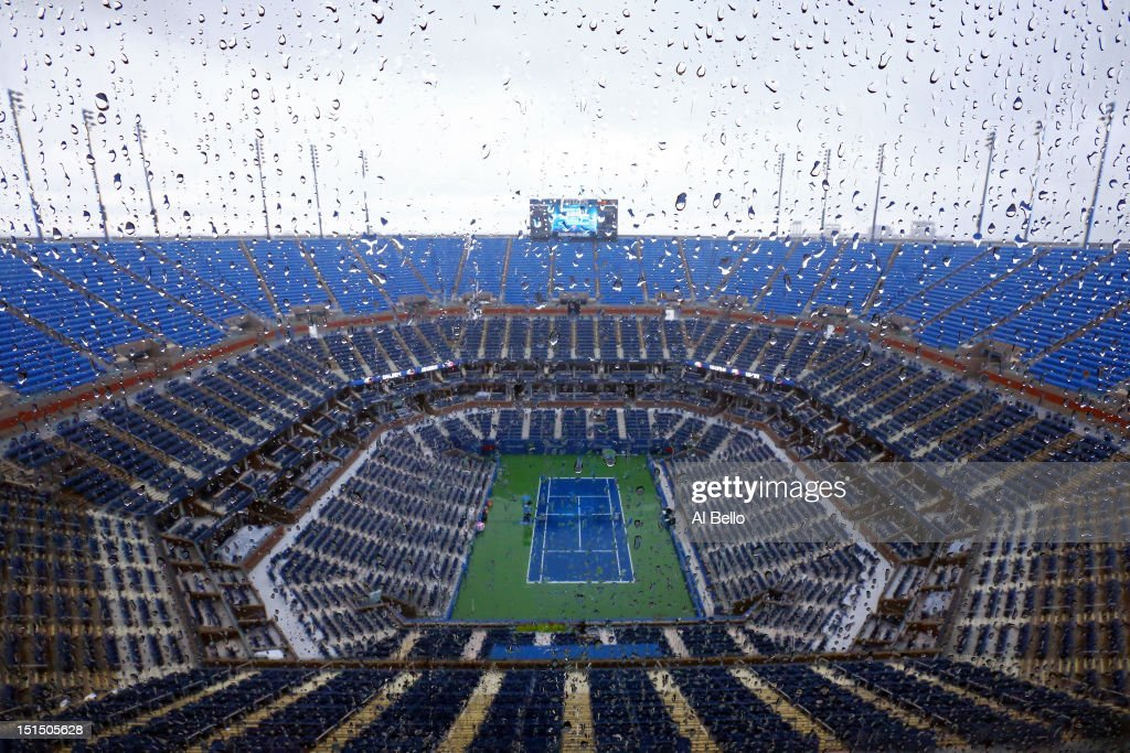 Rain falls on center court in Arthur Ashe stadium to suspend play on Day Thirteen of the 2012 US Open at USTA Billie Jean King National Tennis Center on September 8, 2012 in the Flushing neighborhood of the Queens borough of New York City.