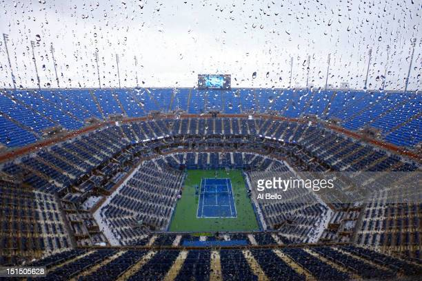 Rain falls on center court in Arthur Ashe stadium to suspend play on Day Thirteen of the 2012 US Open at USTA Billie Jean King National Tennis Center...