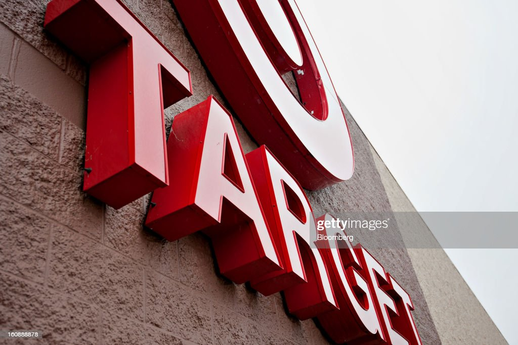 Rain falls on the Target Corp. logo displayed outside of a store in Peru, Illinois, U.S., on Thursday, Feb. 7, 2013. Target Corp. led U.S. retailers to the biggest monthly same-store sales gain in more than a year as shoppers snapped up discounted merchandise chains were clearing out after the holidays. Photographer: Daniel Acker/Bloomberg via Getty Images