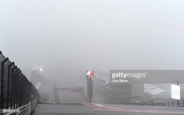 Rain falls on the track after the afternoon practice session was suspended due to weather ahead of the United States Formula One Grand Prix at...