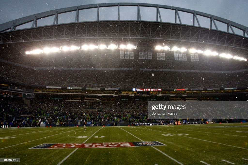 Rain falls to delay the game between the San Francisco 49ers and the Seattle Seahawks at Qwest Field on September 15, 2013 in Seattle, Washington.