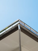 Rain gutter system on roof of House against Blue Sky -  Can use for illustration product