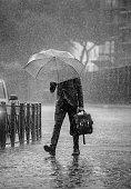 Rain man, crossing the street in torrential rain