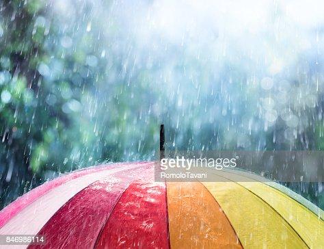 Rain On Rainbow Umbrella : Stock Photo