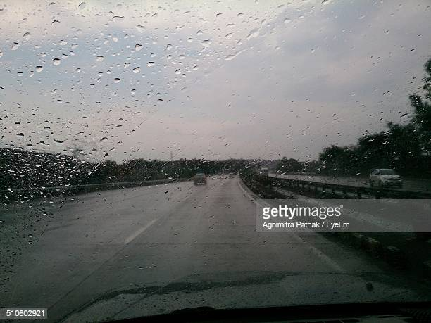 Rain on windshield of car seen from inside car