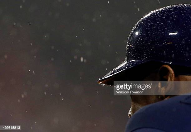 Rain pelts the helmet of a Tampa Bay Rays player during the seventh inning of the game against the Boston Red Sox at Fenway Park on May 30 2014 in...