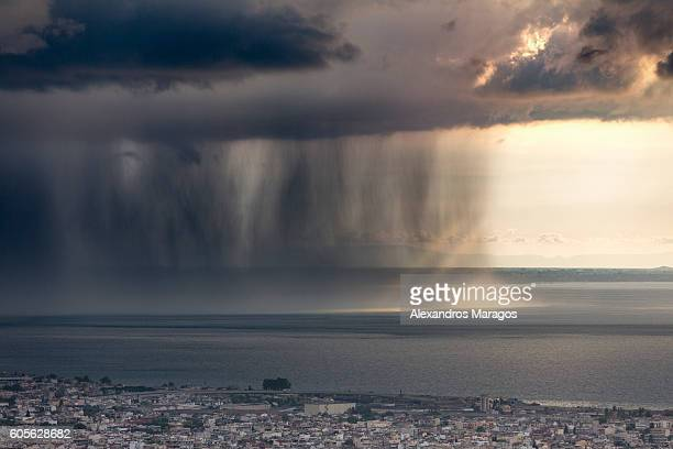 Rain Shaft with dramatic thunder cloud over the ocean