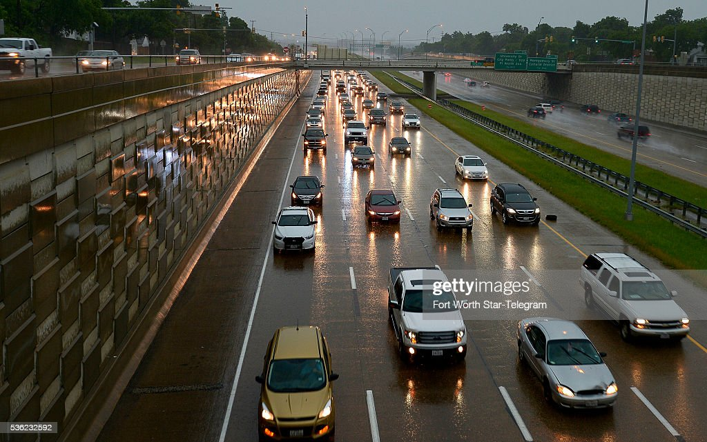Rain slows down rush hour traffic on I-30 in West Fort Worth, Texas, on Tuesday, May 31, 2016, with a flash flood watch in effect and more rain expected Wednesday.