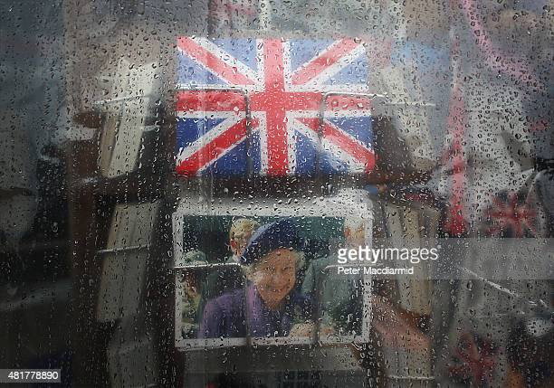 Rain soaked plastic sheeting protects souvenirs on display near Parliament on July 24 2015 in London England Downpours are being experienced in parts...