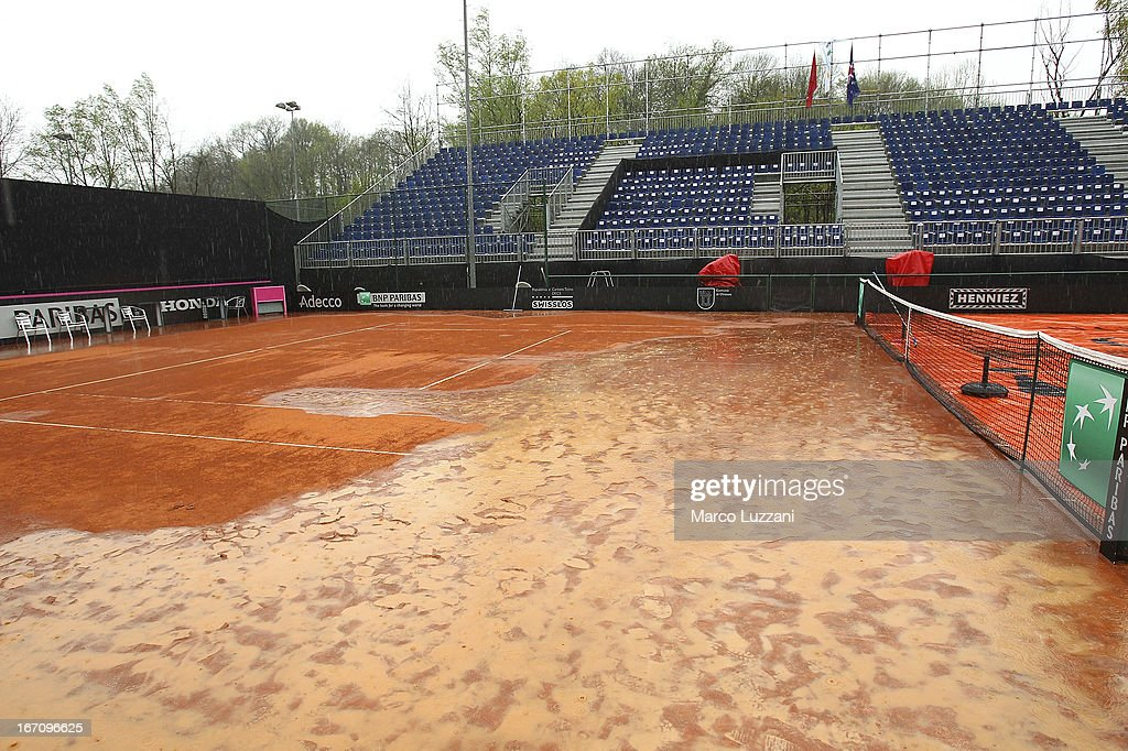 Rain water covers part of the central court during day one of the Fed Cup World Group Play-Offs between Switzerland and Australia at Tennis Club Chiasso on April 20, 2013 in Chiasso, Switzerland.