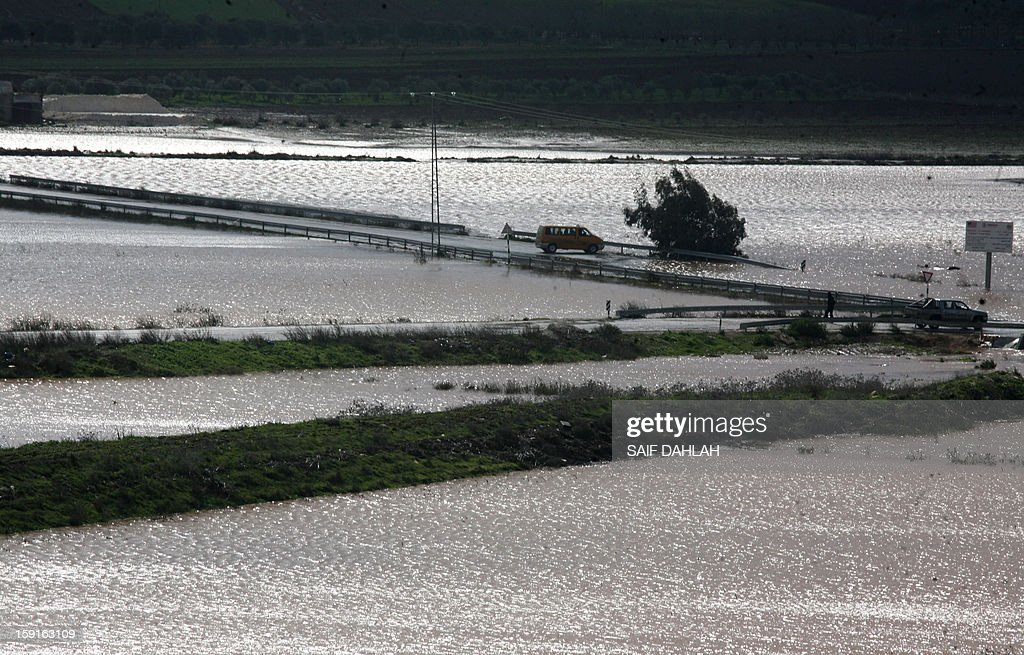 Rain water floods the fields surrounding the village of Qabatiya, in the Israeli occupied West Bank near the northern city of Jenin, on January 9, 2013, as rain and snow engulfs the Levant. AFP PHOTO/SAIF DAHLAH