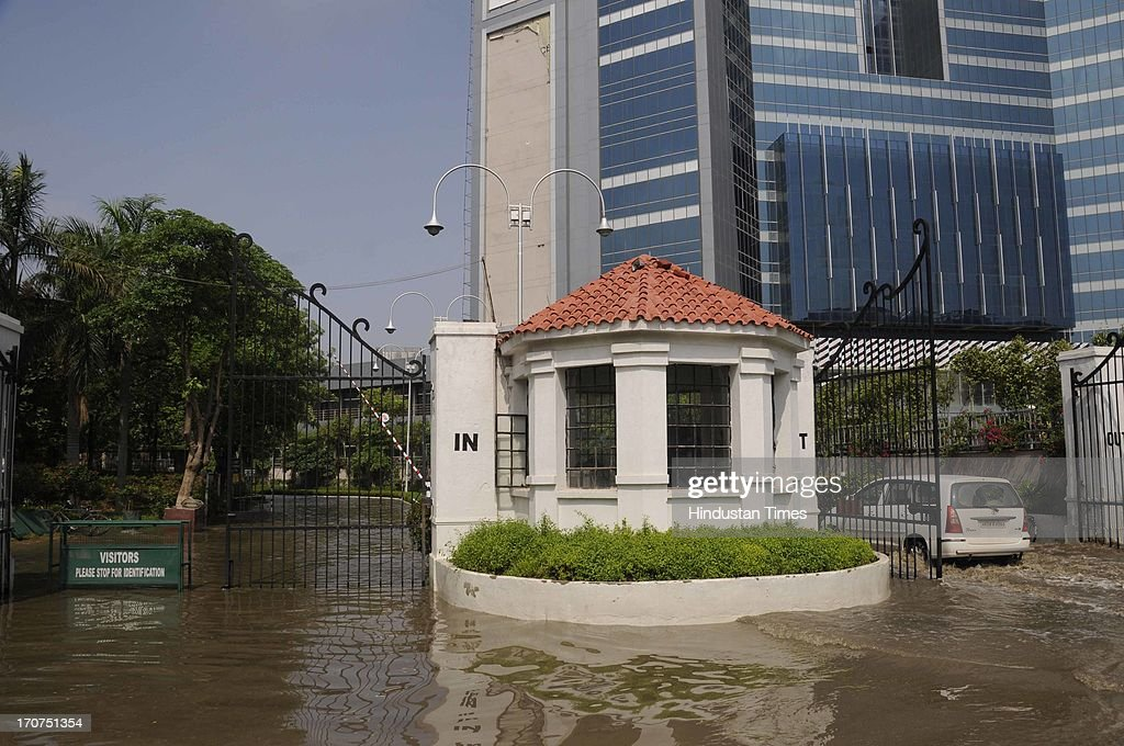 Rain water logging at entry gate of Malibu Town Condominium on June 17, 2013 in Gurgaon, India. The city received 60 mm of rainfall.