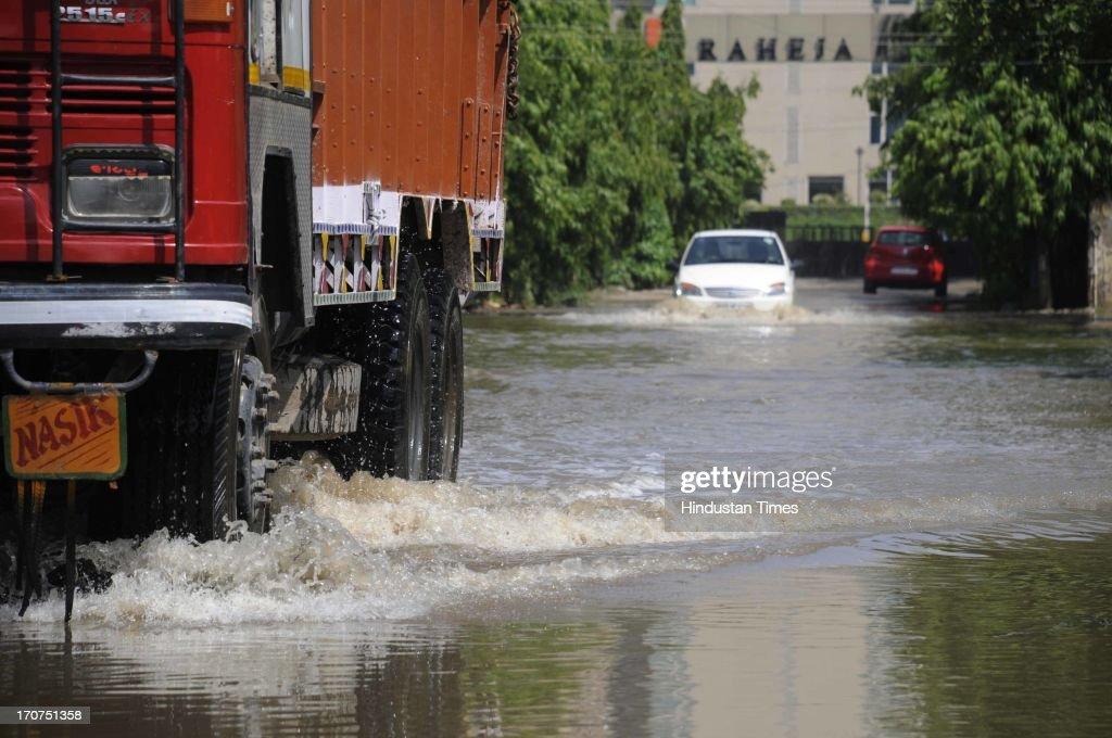 Rain water logging at entry gate of Raheja Atlantis Condominium on June 17, 2013 in Gurgaon, India. The city received 60 mm of rainfall.