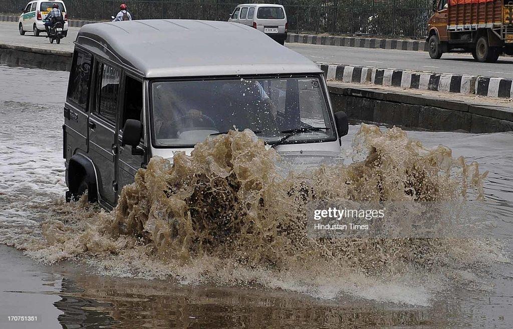 Rain water logging at expressway service lane near Hero Honda Chowk on June 17, 2013 in Gurgaon, India. The city received 60 mm of rainfall.