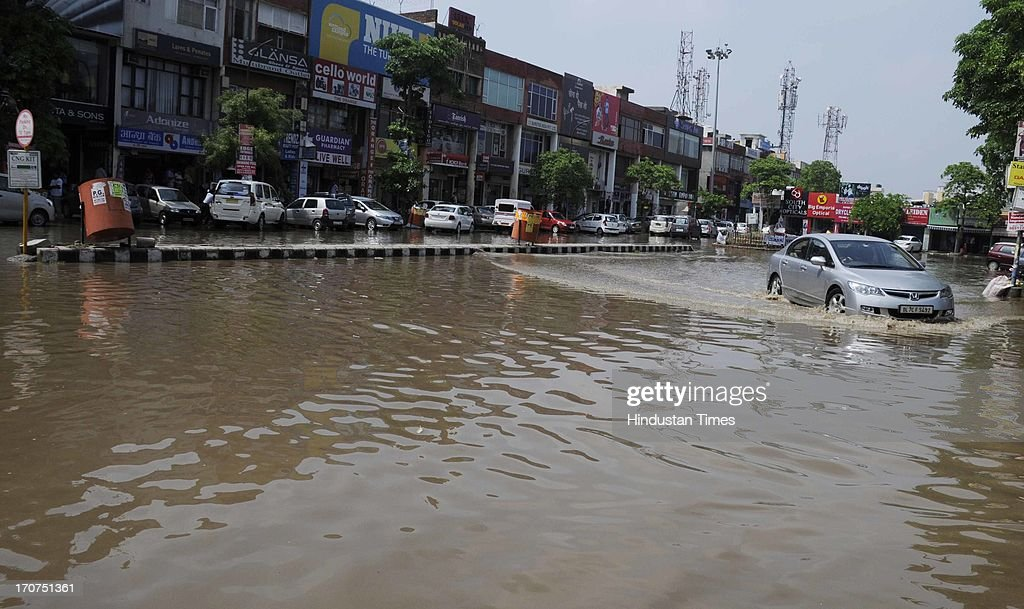 Rain water logging at sector-31 Huda market on June 17, 2013 in Gurgaon, India. The city received 60 mm of rainfall.