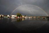 Rainbow above bridge over Shannon river