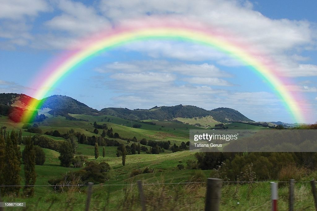 Rainbow above the valley, New Zealand : Stock Photo
