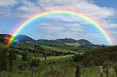 Rainbow above the valley, New Zealand