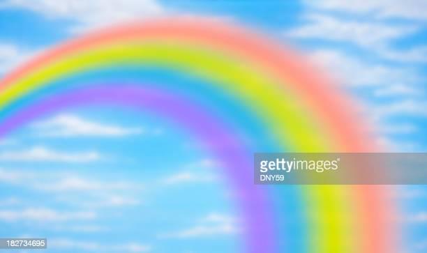Rainbow against fanciful blue sky