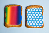 pattern impression on a rusk for breakfast / blue backgroung and black shadow