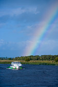 Rainbow and houseboat on Shannon river