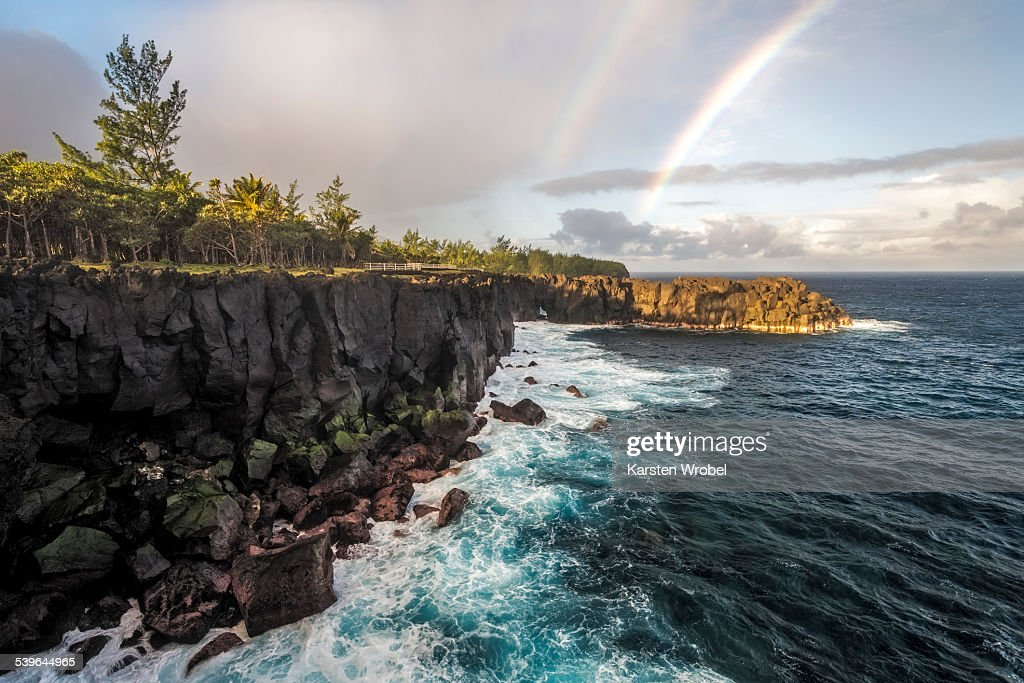 Rainbow and waves of a story sea at Cap Mechant, Wild South, Sud sauvage, Reunion