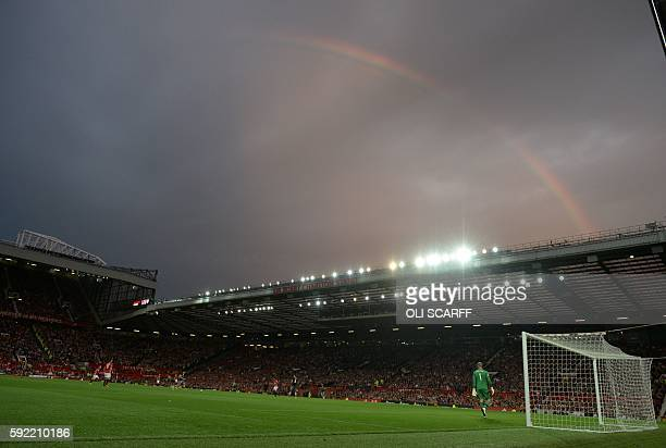 A rainbow appears in the sky during the English Premier League football match between Manchester United and Southampton at Old Trafford in Manchester...