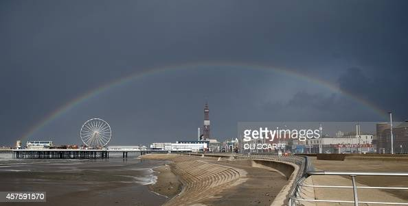A rainbow appears over Blackpool's Central Pier in stormy conditions in Blackpool north west England on October 21 as the tail end of Hurricane...